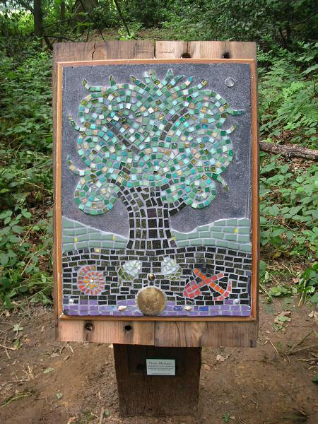 The mosaic in its woodland setting at Hibbert Brow wood.