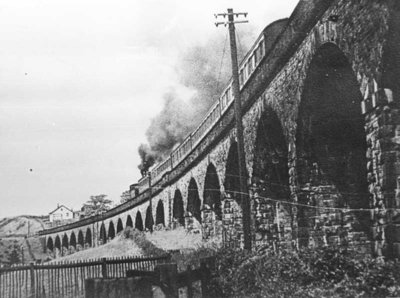 Steam hauled passenger train crossing Bollington viaduct