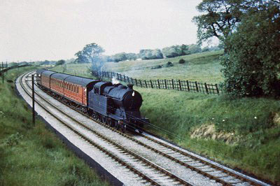 An 'up' passenger train cruising down the gentle slope just north of Whiteley Green